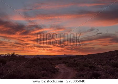 A Fiery Sunset At Perdekloof In The Tankwa Karoo Of South Africa