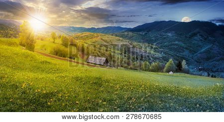 Time Change Above The Rural Field With Dandelions In Mountains. Beautiful Springtime Landscape With