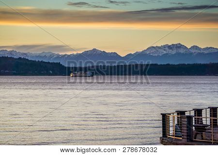 A View Of The Olympic Mountains Across The Puget Sound At Sunset.