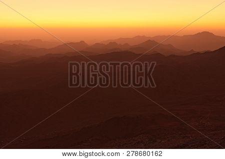 Panoramic landscape view of Mount Sinai (Mount Horeb, Gabal Musa, Moses Mount) during sunrise. Sinai Peninsula of Egypt. Pilgrimage place and famous touristic destination. poster