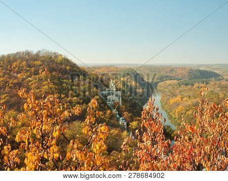 Ukrainian Nature Landscape. Monastery On Hill. Narrow River Flowing Below The Hills. Colorful Autumn