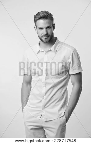 Man On Calm Face Posing Confidently With Hands In Pockets. Man Look Attractive In Casual Linen Shirt