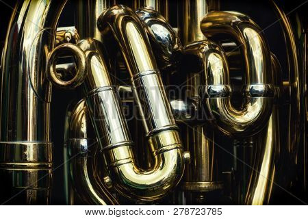 Detail of the brass pipes of a tuba
