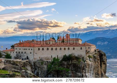 Agios Stephanos Or Saint Stephen Monastery Located On The Huge Rock With Mountains And Town Landscap