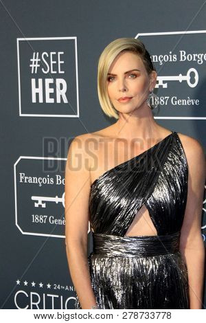 LOS ANGELES - JAN 13:  Charlize Theron at the Critics Choice Awards  at the Barker Hanger on January 13, 2019 in Santa Monica, CA