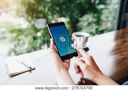 Chiang Mai, Thailand - August 18,2018: Woman Holding Huawei With Skype Apps. Skype Is Part Of Micros