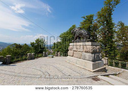 GRAZ, AUSTRIA - JULY 2018 : Hackher lion statue on top of Schlossberg Castle Hill in Graz, Austria on July 20, 2018.