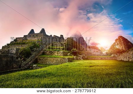 View Of The Stone Ruins Machu Picchu At Sunrise. In The Background Huayna Picchu Mountain In The Clo