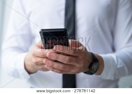 Closeup Of Business Man Browsing On Smartphone. Entrepreneur Holding Digital Device. Communication A