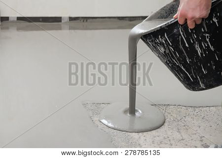 Self-leveling Epoxy. Leveling With A Mixture Of Cement Floors