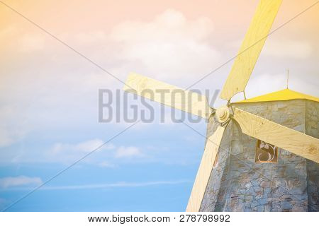 Windmills In The Countryside On A Bright Sky And Sunny Days With Sunlight.