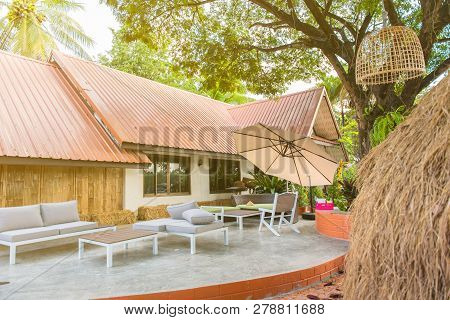 Vintage Back Yard With Outdoor Seating.beautiful Garden House In Country.
