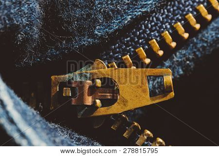 Macro Of Yellow Zipper On Blue Jeans Trousers, Selective Focus Zipper. Royalty High-quality Free Sto