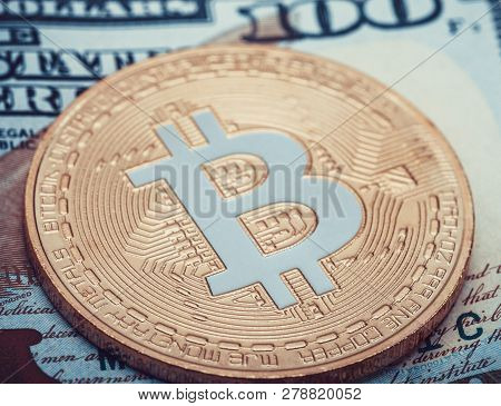 Hundred Usa Dollars Banknote With Golden Bitcoin Over It