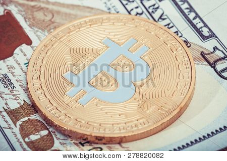 Hundred Usa Dollars With Bitcoin Over It