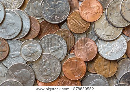 Close-up Of A One Cent, 10 Cent And A Quarter Coins Us Coins