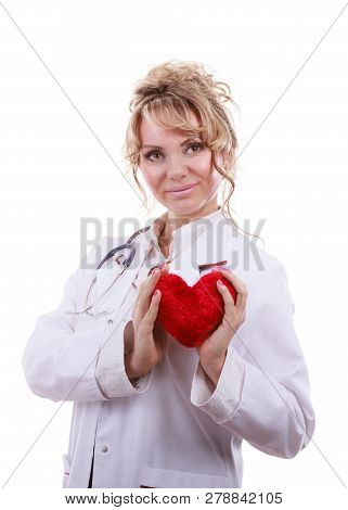 Periodic Examinations. Cardiology Concept. Female Cardiologist Holding Red Heart. Middle Aged Doctor