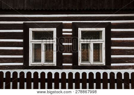 Windows Of A Traditional Wooden Cottage In A Village Of Turiec Region In Northern Slovakia.