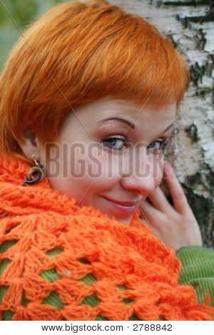 Young Red-Haired Woman In Red Scarf