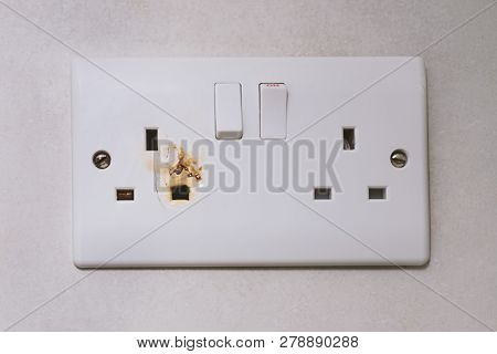 English Type G Electrical Overloaded Power Plug. Broken Power Overload Switch Electric Outlet. Outle
