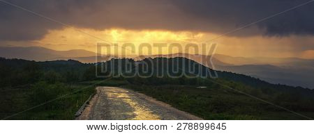 Lonely Road In Mountain Landscape. Panoramic View Of Mountain Layers In Sunset. Lonely Road In Mount