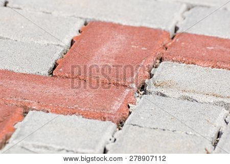 Colored Concrete Flooring Assembled On A Substrate Of Sand Type Of Flooring Permeable To Water .