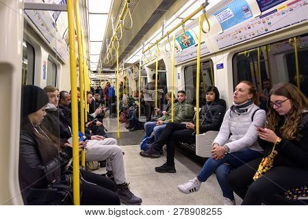 London, Uk - April 30, 2018: Commuters Travel By The Circle Line Tube Train