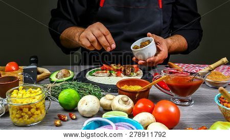 Chef Cooking Mexican Taco. Cook Preparing Delicious Mexican Taco At Kitchen. Tasty Mexican Cuisine.