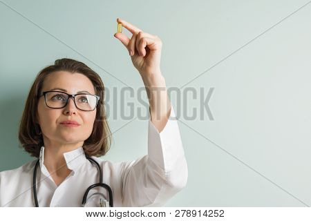 Female Doctor With Vitamin Capsule. Healthy Lifestyle, Nutritional Supplements, Vitamin D, E, Fish O