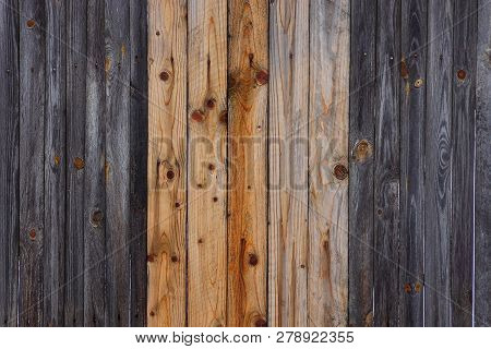 Gray Brown Wooden Texture Of A Series Of Thin Boards In The Wall Of The Fence