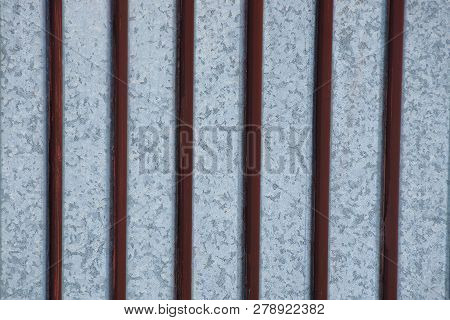 Metal Texture Of Brown Iron Bars On A Gray Wall
