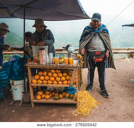 Peru village - 12 October 2018 : Pepople selling fresh juice with juice making tool
