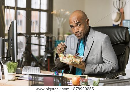 Professional Man Having A Healthy Lunch In His Office