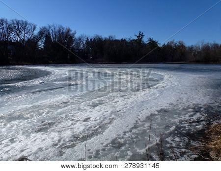 Winter Landscape With The Frozen Lake And Forest