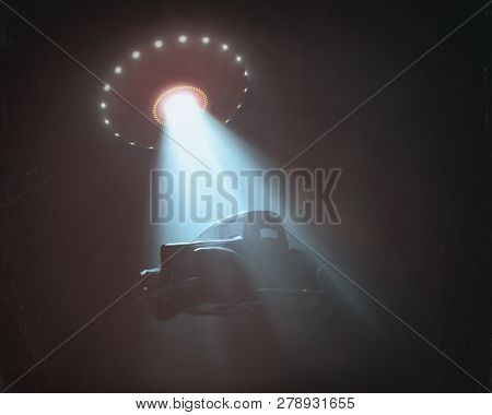 Unidentified Flying Object Lifting A Car. Concept Of Alien Abduction. Old Style Photo With Noise Of