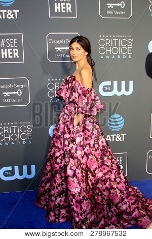 LOS ANGELES - JAN 13:  Gemma Chan at the Critics Choice Awards  at the Barker Hanger on January 13, 2019 in Santa Monica, CA