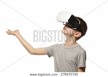 Boy Experiencing Virtual Reality Arm Outstretched In Front Of Him. Isolate On White Background. Tech