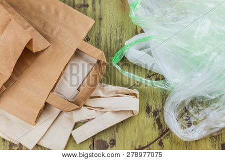 Natural Reusable Linen Fabric And Craft Paper Bags For Shopping Vs Plastic Bags. Eco Friendly Lifest