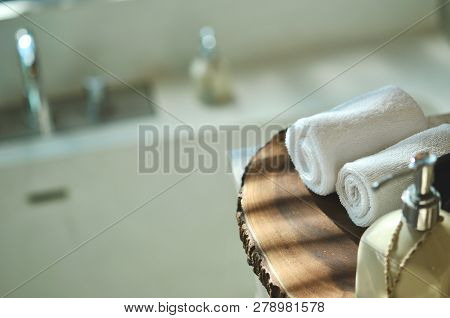 Spa Resort Composition- Wooden Plate And Towel, Place For Relaxation In Modern Wellness Center, Warm