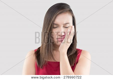 Suffering From A Toothache, Asian Woman Wearing A Red Shirt Suffering From A Toothache While Standin