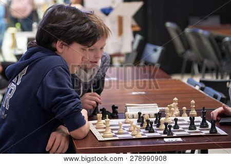 ST. PETERSBURG, RUSSIA - DECEMBER 28, 2018: Kids playing chess in the hall during World Rapid Chess Championship - 2018. The tournament is supported by King of Saudi Arabia Salman