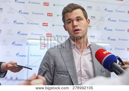 ST. PETERSBURG, RUSSIA - DECEMBER 30, 2018: World Chess Champion Magnus Carlsen, Norway talking with press after winning World Blitz Chess Championship 2018 and becoming World Blitz Champion