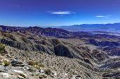 Beautiful overlook of San Bernardino Mountains and Coachella Valley from Joshua Tree's highest viewpoint, Keys View in Joshua Tree National Park, Riverside County, California. poster