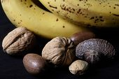 mixed nuts beside bananas poster