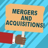 Word writing text Mergers And Acquisitions. Business concept for Refers to the consolidation of companies or assets Hu analysis Hand Holding Blank Colored Placard with Stick photo Text Space. poster