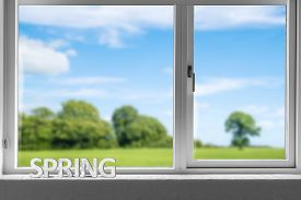Decor Spring In A Window Sill With A View To A Green Garden Under A Blue Sky In The Springtime
