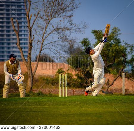 New Delhi India – March 3 2020 : Full Length Of Cricketer Playing On Field During Sunny Day In Local