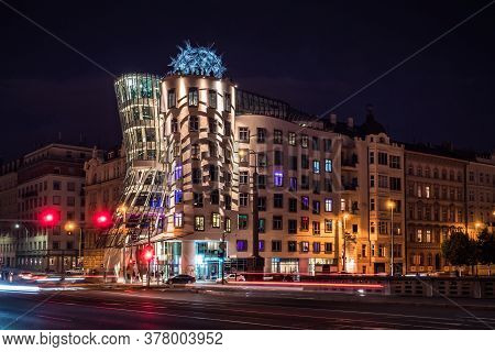 Prague, Czech Republic - July 10 2020: Dancing House At Night, Nicknamed Fred And Ginger, Called Tan