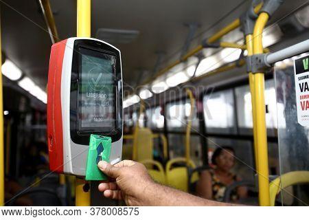 Salvador, Bahia / Brazil - September 8, 2013: Passenger Uses Card To Pay Public Transport Fare When