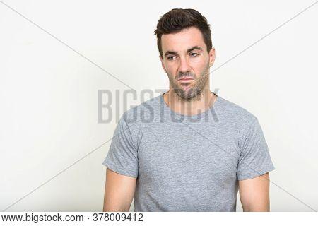 Portrait Of Handsome Hispanic Man With Beard Stubble